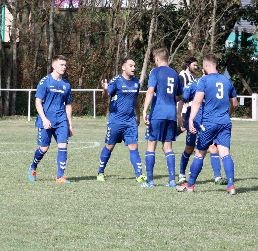 Town secure a historic victory